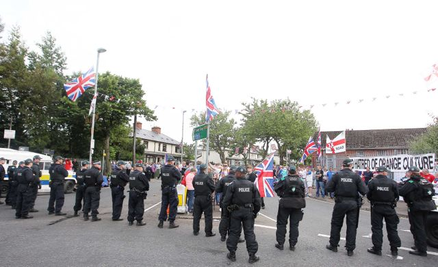 Orangemen parade up to police lines on Twaddell Avenue