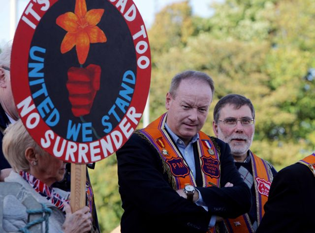 William Humphrey and Nelson McCausland join Orangemen and bandsmen at Twaddell Avenue