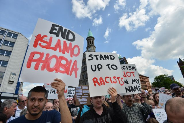 Thousands of peace demonstrators unite against racism  at Belfast city hall.