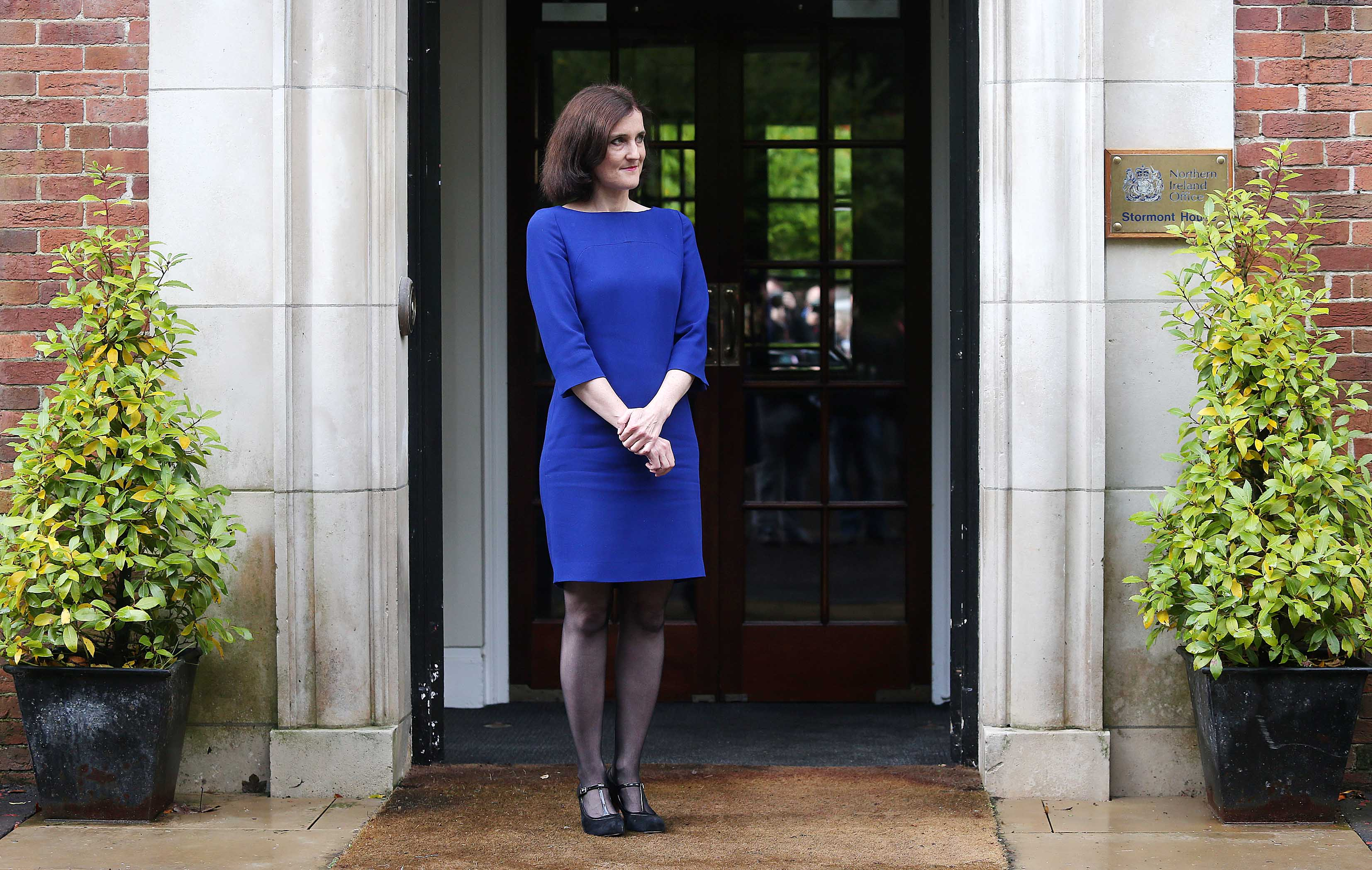 Theresa Villiers waits outside Stormont House.